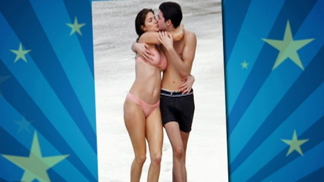VIDEO: Photo captures model on beach kissing her son as his hand is on her breast.