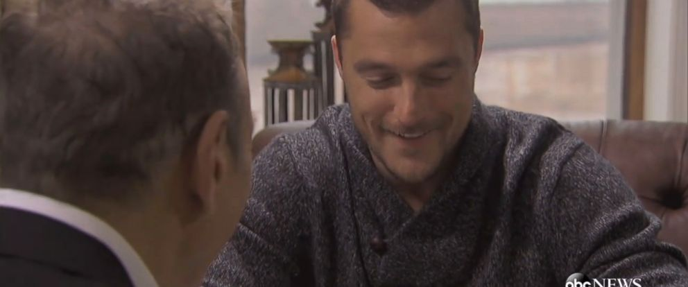 """PHOTO: Chris the Bachelor looks at rings in this """"First Look""""."""
