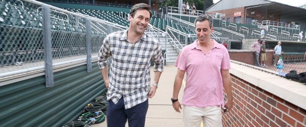 "Both actor Jon Hamm, left, who plays sports agent JB Bernstein, right, in ""Million Dollar Arm"" are shown here on set."