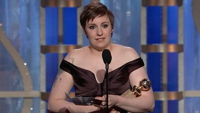 PHOTO: Lena Dunham accepts her award for Best TV Series Actress in a Comedy or Musical, Jan. 13, 2013.