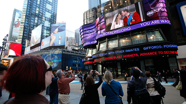 PHOTO: Onlookers watch the live broadcast of The Royal Wedding on ABC News Super Sign in Times Square, April 29, 2011. 4/29/11.