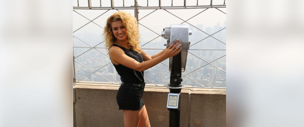 PHOTO: Tori Kelly visiting the Empire State building on July 09, 2015 in New York City.