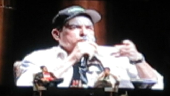 VIDEO: Charlie Sheen closes Toronto show by toasting ashes of an audience members husband.
