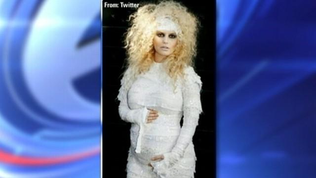 VIDEO: Singer announced her pregnancy in revealing her Halloween costume.