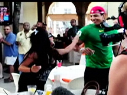 VIDEO: Drinks fly as Snooki gets into a fight with a male clubgoer.