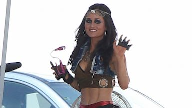 PHOTO: Actress Danica McKellar also will be featured on this new video clip with singer Avril Lavigne, she looked super sexy showing her midriff while cooling off the desert heat with a mini fan in Palmdale, Calif. on July 25, 2013.