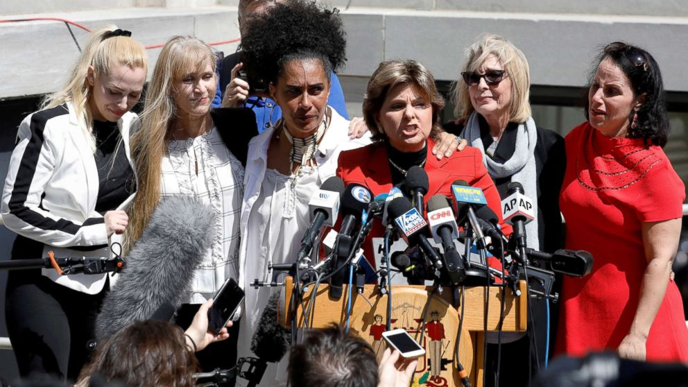Attorney Gloria Allred stands with accusers of actor and comedian Bill Cosby after a jury convicted him in a sexual assault retrial at the Montgomery County Courthouse in Norristown, Pa., April 26, 2018.