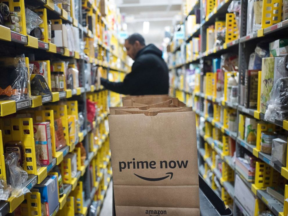 PHOTO: A clerk reaches to a shelf to pick an item for a customer order at the Amazon Prime warehouse in New York, Dec. 20, 2017.