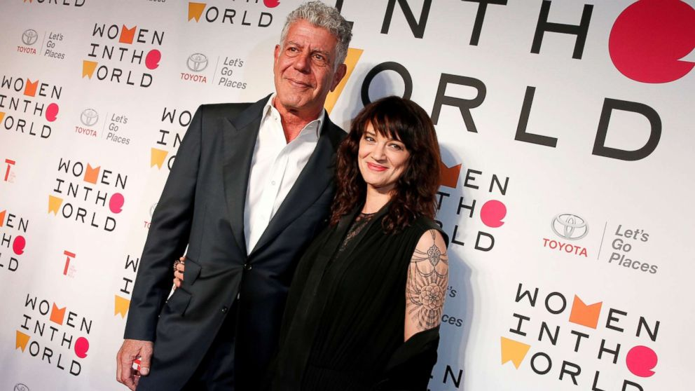 Anthony Bourdain poses with Italian actor and director Asia Argento for the Women In The World Summit in New York, April 12, 2018.