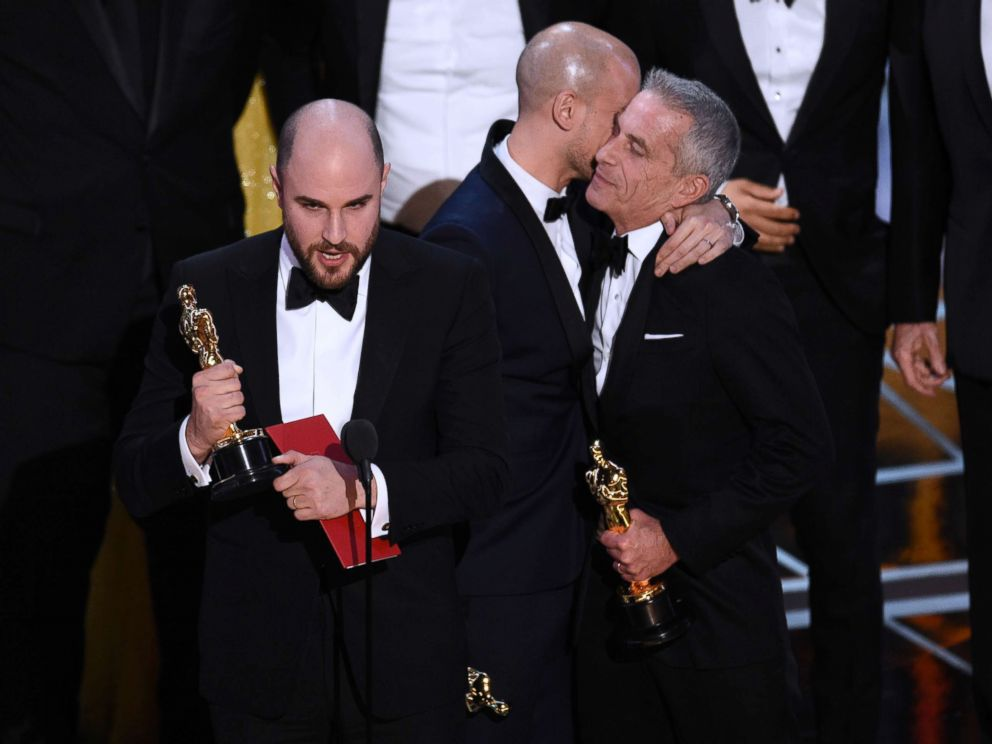 PHOTO: Jordan Horowitz, left, of La La Land, mistakenly accepts the award for best picture at the Oscars on Sunday, Feb. 26, 2017, in Los Angeles.