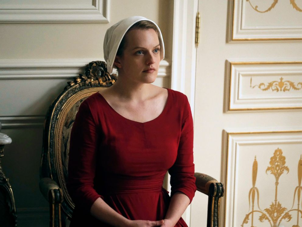 PHOTO: This image released by Hulu shows Elisabeth Moss as Offred in a scene from, The Handmaids Tale, premiering Wednesday on Hulu with three episodes. The remaining seven hours will be released each Wednesday thereafter.