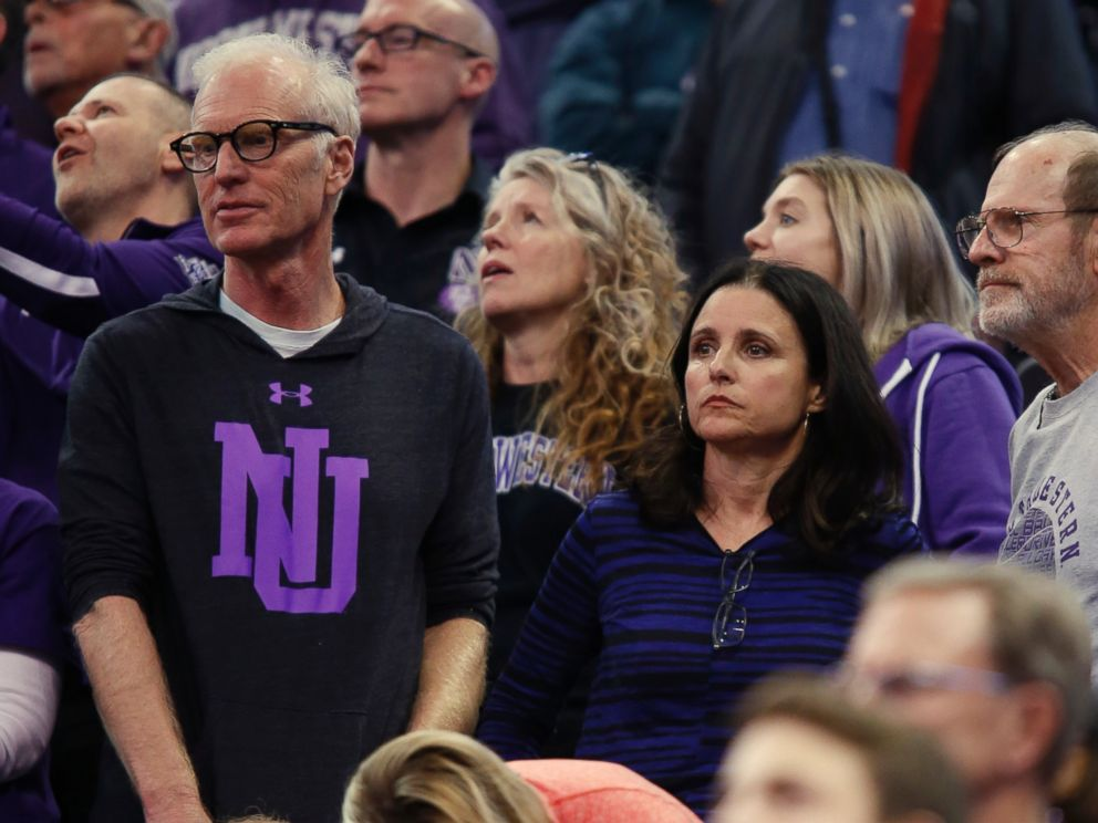 PHOTO: Julia Louis-Dreyfus, lower right, and her husband, producer and writer Brad Hall, left, watch Northwestern play Vanderbilt during a first-round game of the NCAA mens college basketball tournament, March 16, 2017, in Salt Lake City.