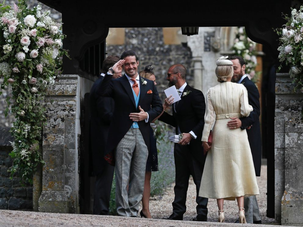 PHOTO: Spencer Matthews, left, gestures as he stands with James Middleton, right, and Donna Air at the entrance of St Marks Church in Englefield, England, ahead of the wedding of Pippa Middleton and James Matthews, May 20, 2017.
