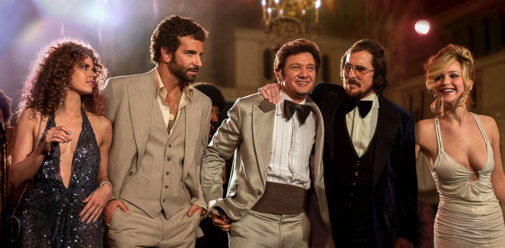 """PHOTO: This film image released by Sony Pictures shows, from left, Amy Adams, Bradley Cooper, Jeremy Renner, Christian Bale and Jennifer Lawrence in a scene from """"American Hustle."""""""