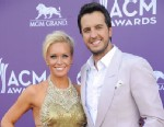 PHOTO: Singer Luke Bryan, right, and Caroline Bryan arrive at the 48th Annual Academy of Country Music Awards at the MGM Grand Garden Arena in Las Vegas on Sunday, April 7, 2013.