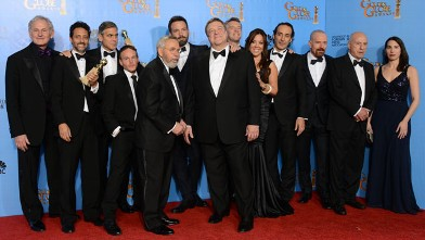 """PHOTO: Actor and director Ben Affleck, sixth from left, and the cast and crew of """"Argo"""" pose with the award for best motion picture - drama for """"Argo"""" backstage at the 70th Annual Golden Globe Awards, Jan. 13, 2013, in Beverly Hills, Calif."""
