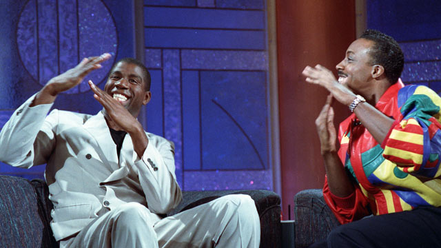 "PHOTO: Earvin ""Magic"" Johnson, left, and host Arsenio Hall gesture for time during taping of the Arsenio Hall Show Nov. 9, 1991 in Los Angeles."