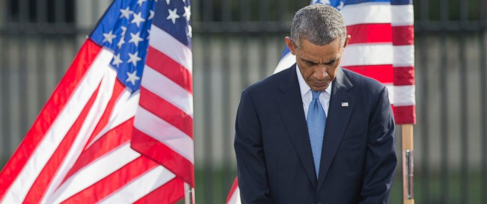 PHOTO: President Barack Obama bows his head during a moment of silence at the Pentagon, Sept. 11, 2014, during a ceremony to mark the 13th anniversary of the 9/11 attacks.