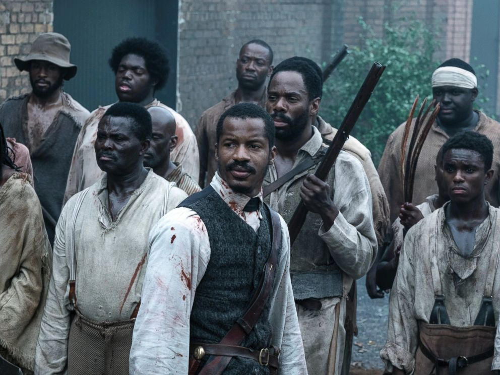 PHOTO: This image released by Fox Searchlight Films shows Nate Parker as Nat Turner, center, in a scene from The Birth of a Nation.
