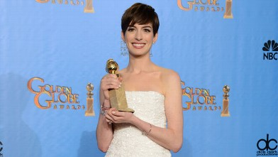 """PHOTO: Anne Hathaway poses with the award for best performance by an actress in a supporting role in a motion picture in """"Les Miserables"""" backstage at the 70th Annual Golden Globe Awards, Jan. 13, 2013, in Beverly Hills, Calif."""