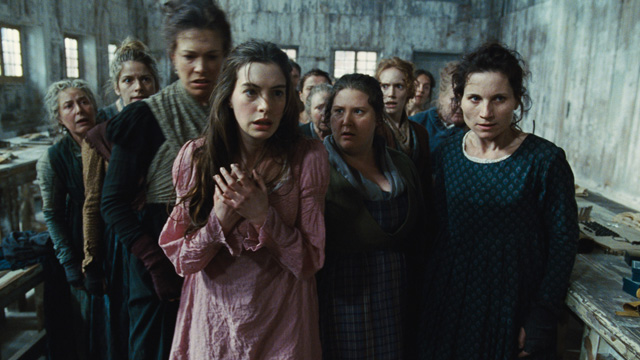 """PHOTO: This undated publicity photo provided by Universal Pictures shows Anne Hathaway, left, as Fantine, being thrown out of the factory in a scene from director, Tom Hoopers new film, """"Les Misérables,"""" the motion-picture adaptation of the beloved globa"""
