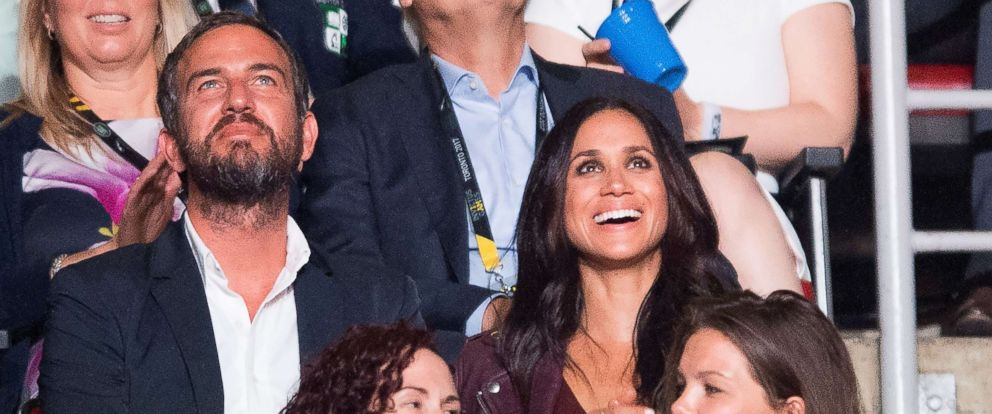 PHOTO: Meghan Markle, top right, attends the Invictus Games Opening Ceremonies in Toronto on Saturday, Sept. 23, 2017, a few rows apart from her boyfriend, Britains Prince Harry.