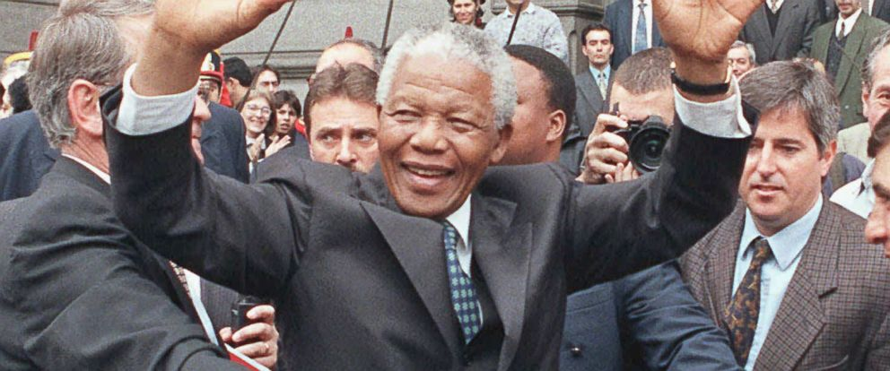 PHOTO: In this July 23, 1998 file photo, South African President Nelson Mandela greets a crowd outside the National Congress building in Buenos Aires, Argentina.