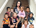 "PHOTO: Nadya Suleman, also known as ""Octomom,"" rear center, poses with some of her children at their new home in Palmdale, Calif., Oct. 23, 2012."