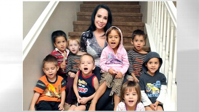"""PHOTO: Nadya Suleman, also known as """"Octomom,"""" rear center, poses with some of her children at their new home in Palmdale, Calif., Oct. 23, 2012."""