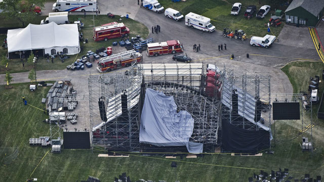 PHOTO: This aerial view shows a collapsed concert stage being set up for a concert by band Radiohead at Downsview Park in Toronto, Saturday, June 16, 2012.
