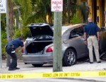 PHOTO: A Rolls Royce driven by rapper Rick Ross is examined by police after the car was crashed into an apartment building, Jan. 28, 2013 in Fort Lauderdale, Fla.