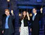 "PHOTO: From left: Prince Harry, Kate the Duchess of Cambridge, and Prince William, raise their wands on the film set used to depict Diagon Alley in the Harry Potter Films during the inauguration of ""Warner Bros. Studios Leavesden"" near Watford, England, A"
