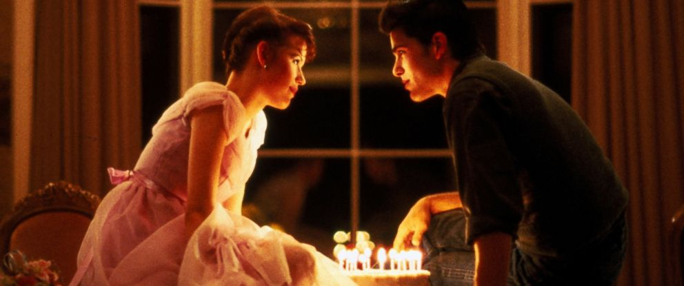"""PHOTO: In this 1984 film publicity image released by Universal Pictures, Molly Ringwald, left, and Michael Schoeffling are shown in a scene from """"Sixteen Candles."""""""
