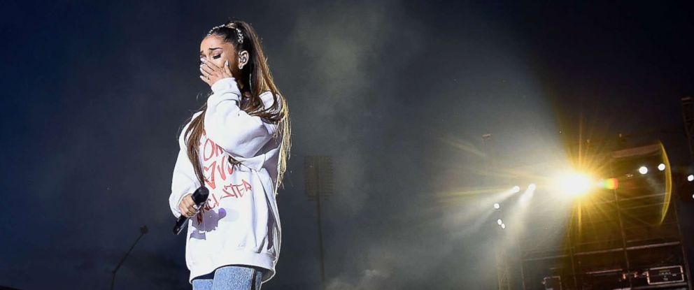 PHOTO: Ariana Grande wipes away a tear as she performs on stage during the One Love Manchester Benefit Concert at Old Trafford Cricket Ground on June 4, 2017 in Manchester, England.