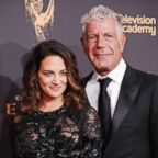 Asia Argento and Anthony Bourdain attend the 2017 Creative Arts Emmy Awards at Microsoft Theater in this Sept. 9, 2017 in Los Angeles.