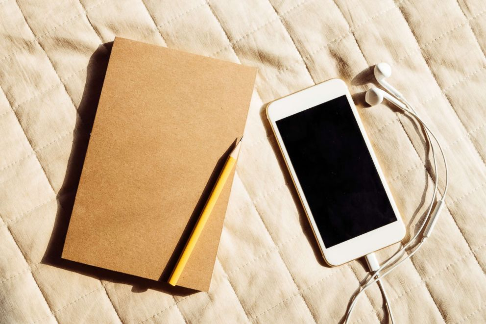 PHOTO: Journals and audio books can be relaxing activities when traveling.