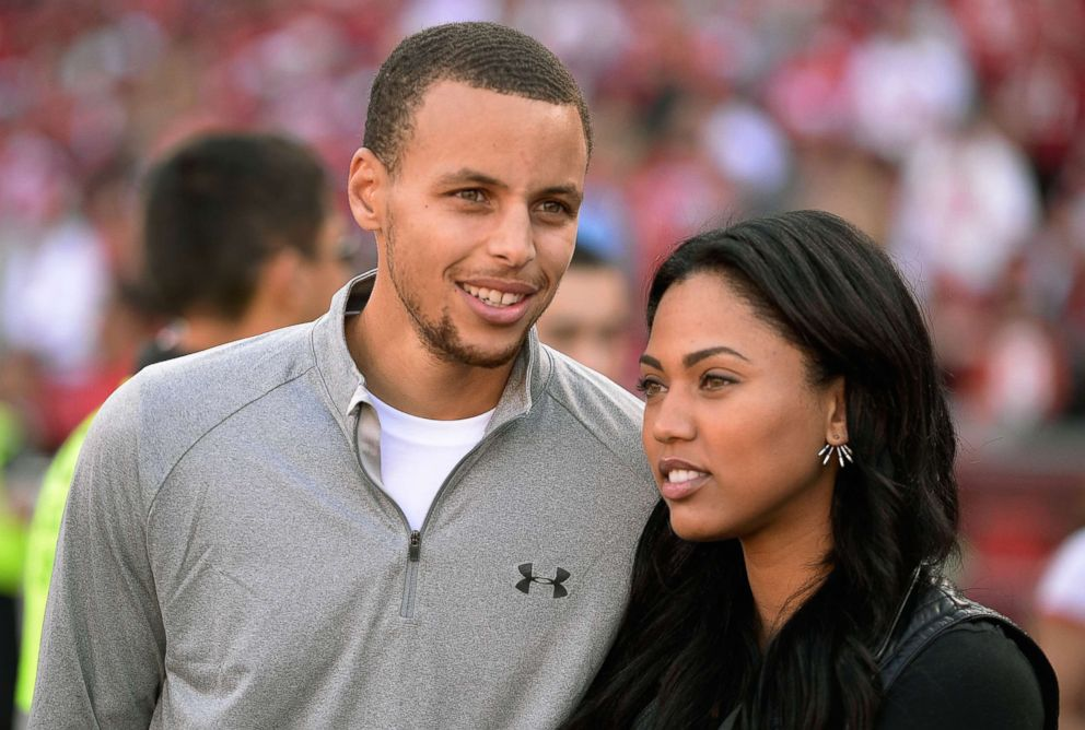 PHOTO: Stephen Curry and his wife Ayesha attend an NFL Game at Candlestick Park, Nov. 10, 2013 in San Francisco.