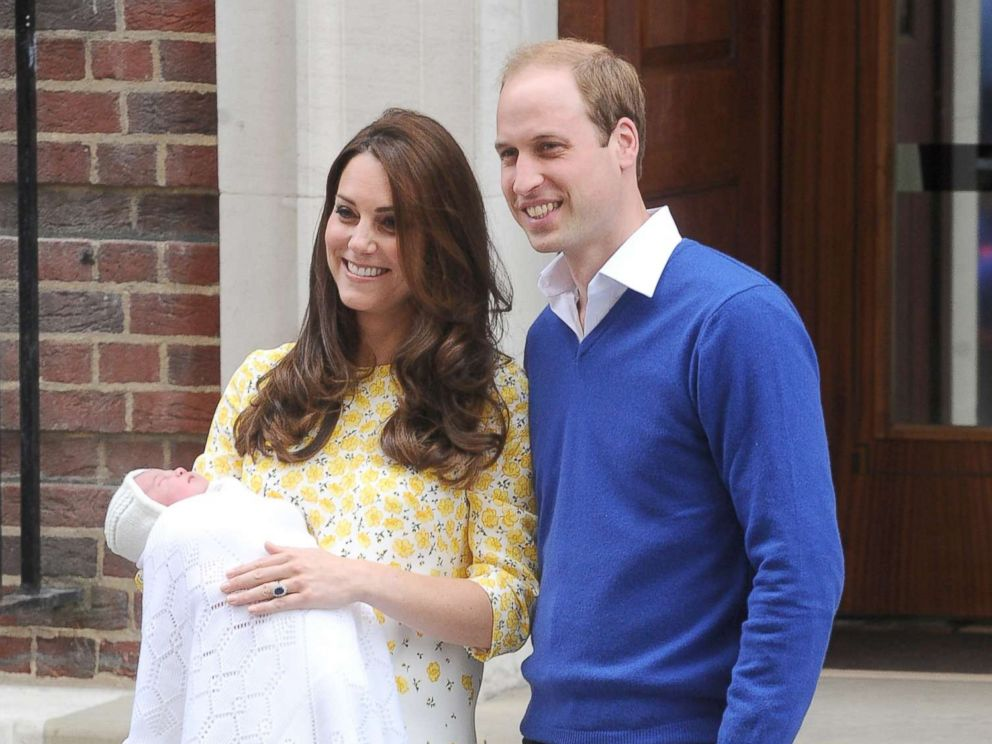 PHOTO: Prince William, Duke of Cambridge and Catherine, Duchess of Cambridge show off their new arrival, Princess Charlotte to the world outside the Lindo Wing of St. Marys Hospital, May 2, 2015, in London.