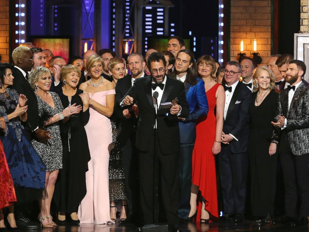 Playwright Tony Kushner, center, and the cast and crew of Angels in America accept the award for best revival of a play at the 72nd annual Tony Awards at Radio City Music Hall on Sunday, June 10, 2018, in New York.