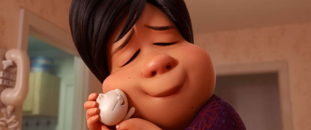 "PHOTO: The mother in Pixars new short ""Bao"" hugs a baby dumpling that comes to life."