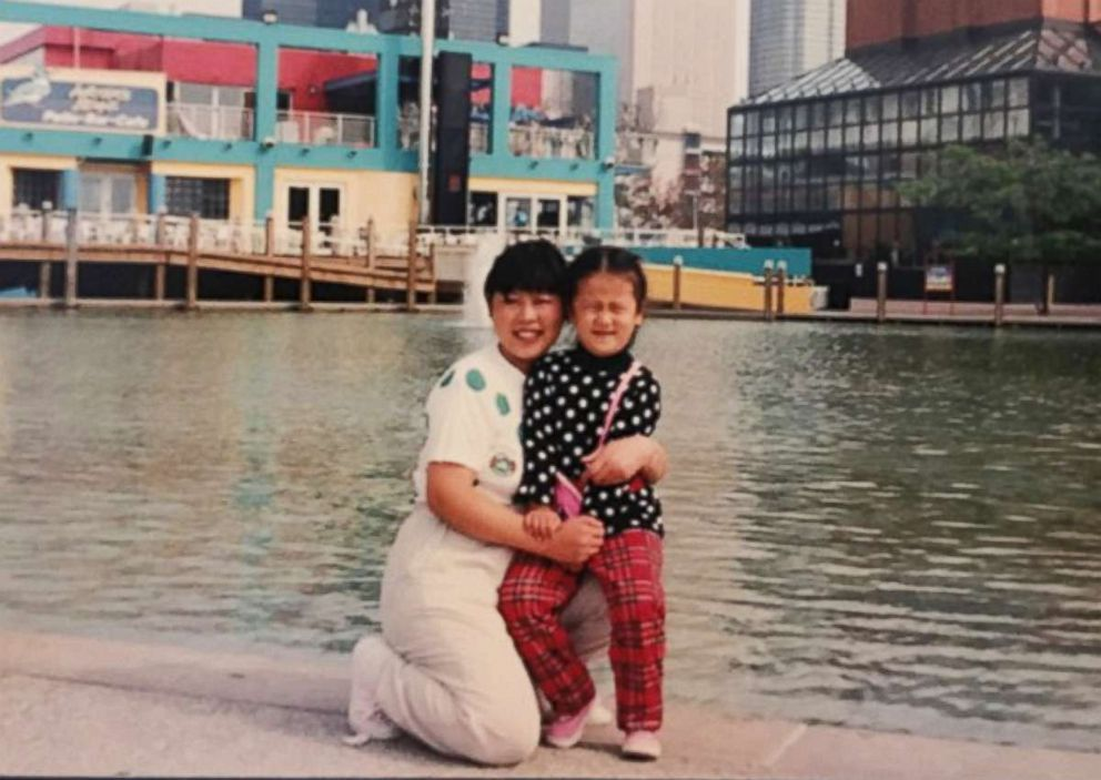 A younger Domee Shi and her mother.