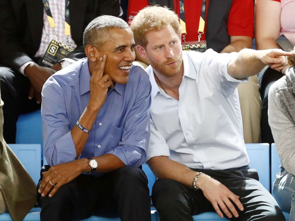 PHOTO: Britains Prince Harry (R) gestures while watching a wheelchair basketball event with former President Barack Obama at the Invictus Games in Toronto, Sept. 29, 2017.