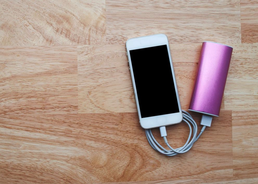 PHOTO: A smart phone is attached to a portable battery charger in this undated stock image.