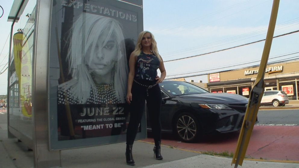 Bebe Rexha posed in front of a billboard that was barely five blocks away from her childhood home.