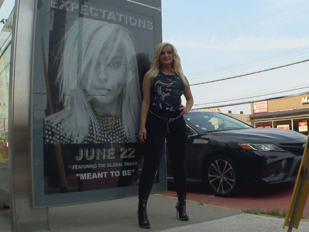 PHOTO: Bebe Rexha posed in front of a billboard that was barely five blocks away from her childhood home.