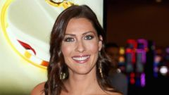 """PHOTO: Television personality Becca Kufrin attends an unveiling of """"The Bachelor"""" themed slot machine at the MGM Grand Hotel & Casino, May 17, 2018, in Las Vegas."""