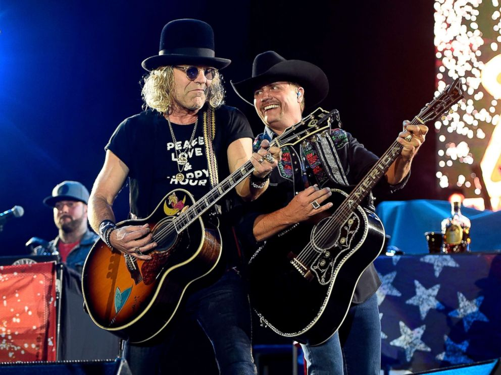 PHOTO: Recording artists Big Kenny (L) and John Rich of Big & Rich perform during the Route 91 Harvest country music festival at the Las Vegas Village, Oct. 1, 2017 in Las Vegas, Nevada.