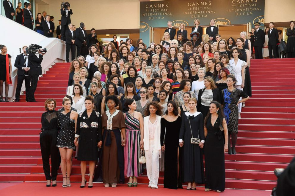 PHOTO: Jury head Cate Blanchett with other filmmakers reads a statement on the steps of the red carpet in protest of the lack of female filmmakers honored throughout the history of the festival during the Cannes Film Festival, May 12, 2018 in Cannes.