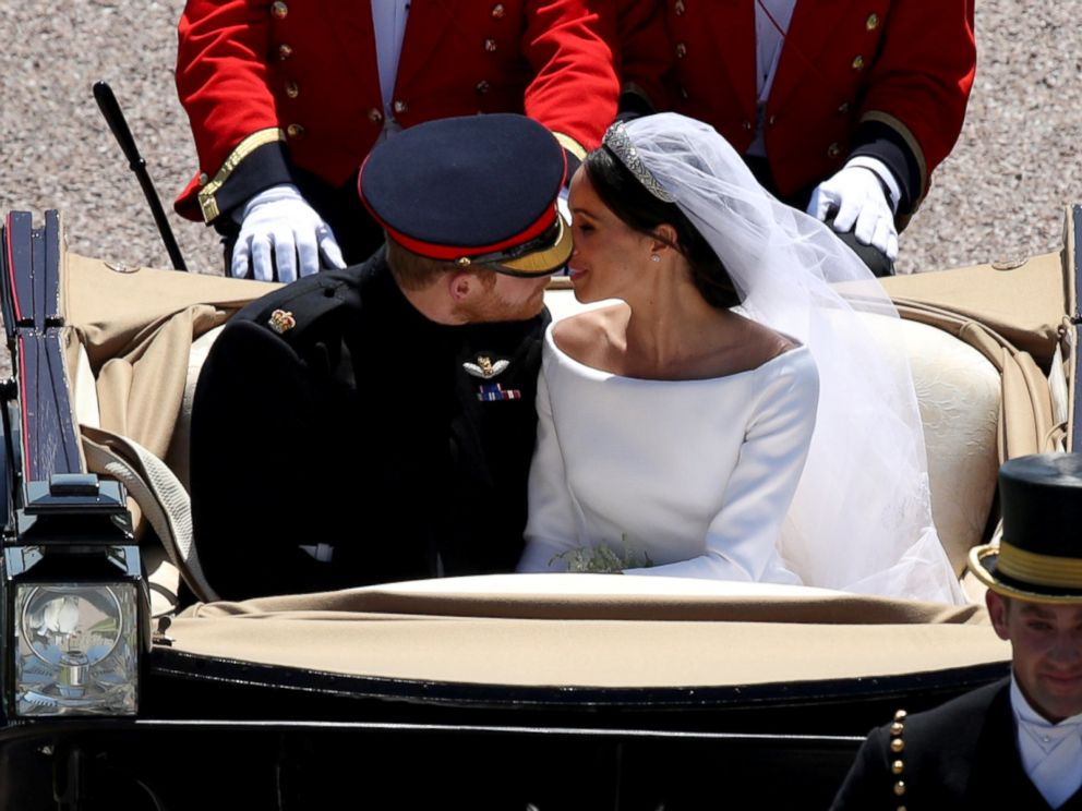 PHOTO: Prince Harry and Meghan Markle ride in an Ascot Landau along the Long Walk after their wedding in St Georges Chapel in Windsor Castle in Windsor, May 19, 2018.