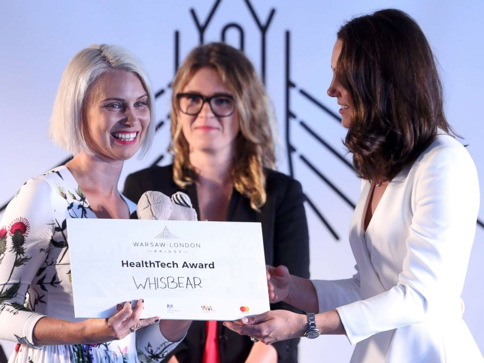 PHOTO: Britains Catherine, Duchess of Cambridge awards Zuzanna Sielicka-Kalczynska from the Whisbear The Humming Bear company with the Health Tech Award at the Heart business incubator in the Warsaw Spire building in Warsaw, Poland, July 17, 2017.